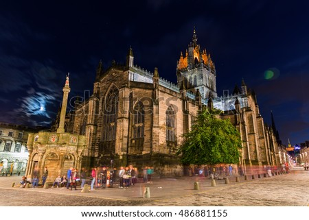 Edinburgh, Scotland - September 10, 2016: St. Giles Cathedral with unidentified people at night. Its distinctive crown steeple is a prominent feature of the city skyline