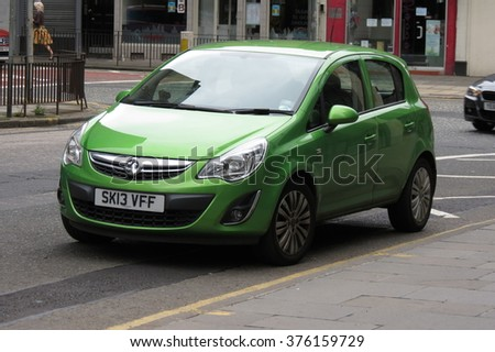 EDINBURGH, SCOTLAND, UK - CIRCA AUGUST 2015: green Vauxhall Astra car in a street of the city centre. - stock photo