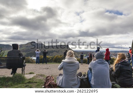 EDINBURGH-SCOTLAND, UK- MARCH 20 : Crowd gathered on Calton hill to witness unique phenomenon of the sun eclipse event on March 20, 2015.