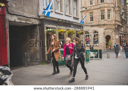 EDINBURGH, SCOTLAND / UNITED KINGDOM - MAY 24 2015 - Unidentified group of women, walking and laughing on the streets of Edinburgh. - stock photo