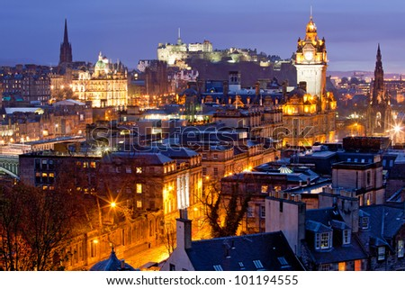Edinburgh Skylines building and castle from Calton Hill at dusk Scotland UK - stock photo