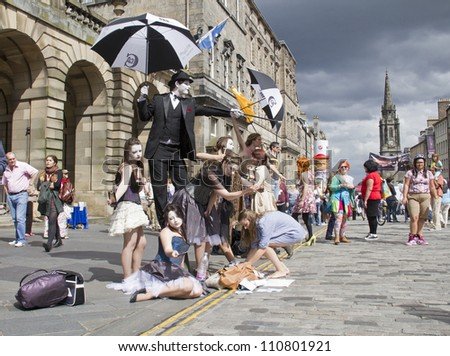 EDINBURGH, UK AUGUST 2: Performers on the Royal Mile at the Edinburgh Festival Fringe in Edinburgh, UK on August 2, 2012 - stock photo