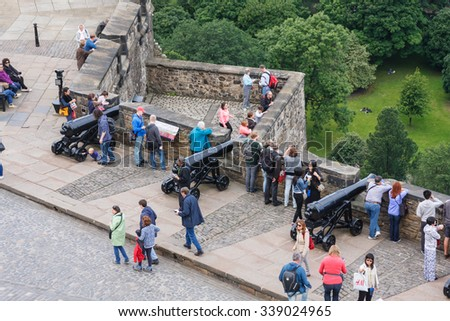 EDINBURGH, UNITED KINGDOM - JULY 24, 2015: unknown visitors enjoy the view from Edinburgh Castle. With over 1.4 million visitors a year, the castle is a major tourist attraction. - stock photo
