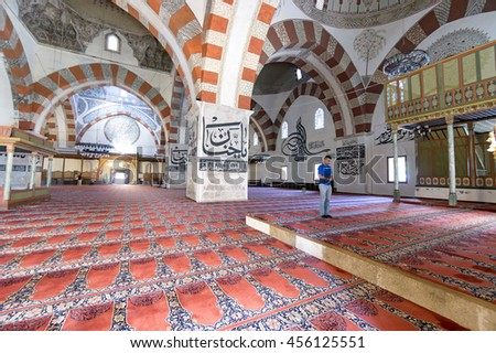 EDIRNE - TURKEY, JULY 12: Undefined muslims praying in Edirne Old Mosque on july 12, 2016. The Old Mosque is an early 15th century Ottoman mosque in Edirne, Turkey