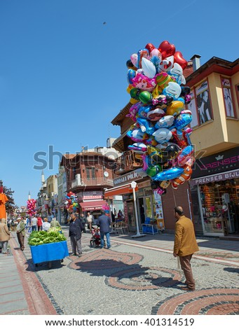 EDIRNE, TURKEY, 02.04.2016: View to crowded street with shops, hotels, transport and people in Bazaar Edirne in Edirne Turkey.