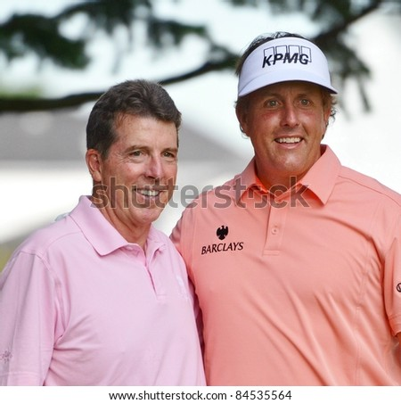 EDISON,NJ-AUGUST 24: Barclays CEO Robert Diamond (L) with golfer Phil Mickelson during the Barclays pro-am held at the Plainfield Country Club on August 24, 2011 in Edison,NJ. - stock photo