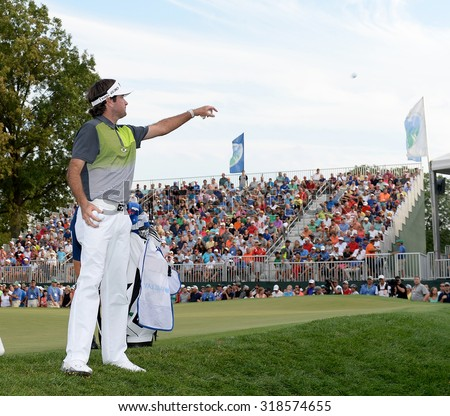 EDISON,NJ- AUGUST 30: Bubba Watson tosses golf balls to his fans at the 18th hole after this final round of the Barclays Tournament held at the Plainfield Country Club  in Edison,NJ,August 30,2015. - stock photo