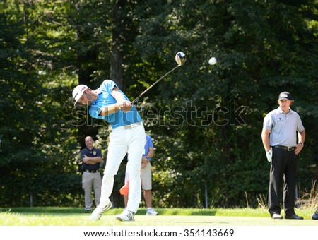 EDISON,NJ-AUGUST 25:Dustin Johnson (L) drives his ball down the fairway during the Barclays Tournament practice rounds held at the Plainfield Country Club in Edison,NJ,August 25,2015.  - stock photo