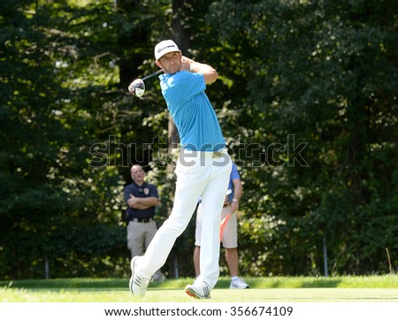 EDISON,NJ-AUGUST 25:Dustin Johnson watches his shot during the Barclays Tournament practice round held at the Plainfield Country Club in Edison,NJ,August 25,2015. - stock photo