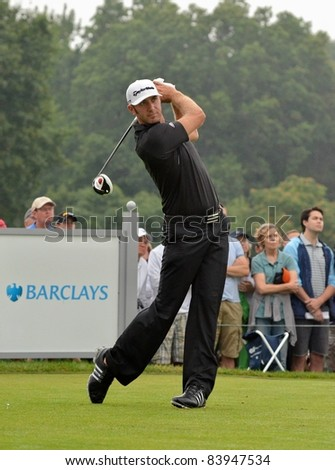 EDISON, NJ-AUGUST 27: Golfer Dustin Johnson tees off at the 2nd tee during the final round of the Barclays tournament  at the Plainfield Country Club on August 27, 2011 in Edison, NJ. - stock photo