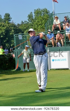 EDISON,NJ-AUGUST 26: Golfer Ernie Els watches his shot during the second round of the Barclays Tournament held at the Plainfield Country Club on August 26, 2011 in Edison, N.J. - stock photo