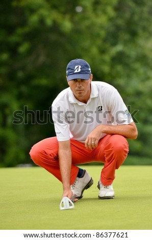EDISON,NJ-AUGUST 27: Golfer Matt Kurcher lines up his putt  on the 18th green during the final round of the Barclays Tournament held at the Plainfield Country Club on August 27,2011 in Edison,NJ. - stock photo
