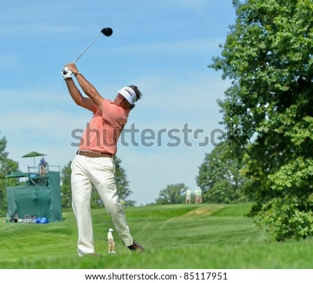 EDISON,NJ-AUGUST 24: Golfer Phil Mickelson watches his shot during the Barclays pro-am held at the Plainfield Country Club on August 24,2011 in Edison,NJ. - stock photo