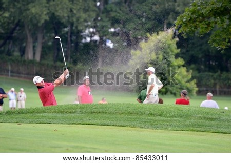 EDISON,NJ-AUGUST 26: Golfer Steve Stricker takes a shot from a bunker during the second round of the Barclays Tournament held at the Plainfield Country Club on August 26,2011 in Edison,NJ.