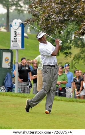 EDISON,NJ - AUGUST 27: Golfer Vijay Singh watches his shot during the final round of the Barclays Tournament held at the Plainfield Country Club on August 27,2011 in Edison,N.J. - stock photo