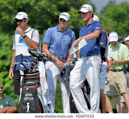 EDISON,NJ-AUGUST 26: Golfers Webb Simpson (R) and Nick Watney (C)  at the tee during the second round of the Barclays Tournament held at the Plainfield Country Club on August 26,2011 in Edison,N.J. - stock photo