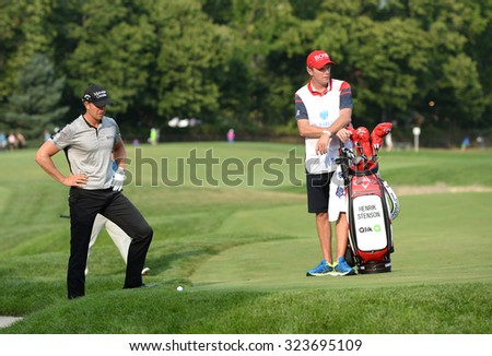 EDISON,NJ-AUGUST 30:Henrik Stenson looks at his ball in the rough at the 18th hole during the final round of the Barclays Tournament held at the Plainfield Country Club in Edison,NJ,August 30,2015. - stock photo