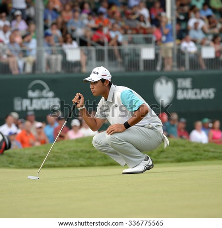 EDISON,NJ-AUGUST 30:Hideki Matsuyama lines up his putt on the 18th hole during the final round of the Barclays Tournament held at the Plainfield Country Club in Edison,NJ,August 30,2015. - stock photo