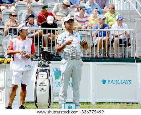 EDISON,NJ-AUGUST 30:Hideki Matsuyama (r) looks down the 1st Tee Fairway during the final round of the Barclays Tournament held at the Plainfield Country Club in Edison,NJ,August 30,2015. - stock photo