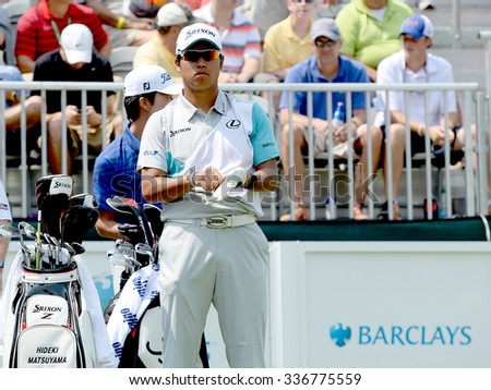 EDISON,NJ-AUGUST 30:Hideki Matsuyama takes a look down the 1st Tee Fairway during the final round of the Barclays tournament held at the Plainfield Country Club in Edison,NJ,August 30,2015. - stock photo