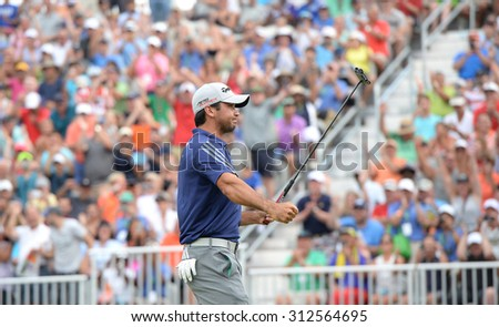 EDISON,NJ-AUGUST 30:Jason Day reacts with the fans after making his final putt on the 18th hole during the Barclays Tournament held at the Plainfield Country Club in Edison,NJ,August 30,2015.