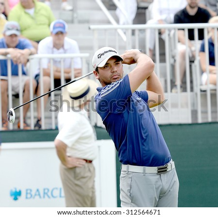 EDISON,NJ-AUGUST 30:Jason Day takes a practice swing while on the 1st Tee during the final round of the Barclays Tournament held at the Plainfield Country Club in Edison,NJ,August 30,2015. - stock photo