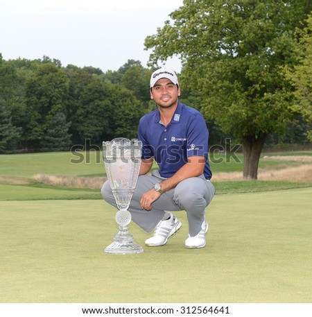 EDISON,NJ-AUGUST 30:Jason Day with the Barclays winner's trophy on the 18th green after the final round of the Barclays Tournament held at the Plainfield Country Club in Edison,NJ,August 30,2015. - stock photo