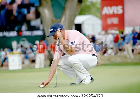 EDISON,NJ-AUGUST 30:Jason Dufner sets up his ball at the 18th hole during the final round of the Barclays tournament held at the Plainfield Country Club in Edison,NJ,August 30,2015. - stock photo
