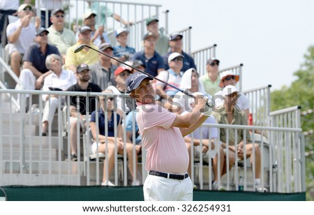 EDISON,NJ-AUGUST 30:Jason Dufner watches his shot from the 1st Tee during the final round of the Barclays tournament held at the Plainfield Country Club in Edison,NJ,August 30,2015. - stock photo