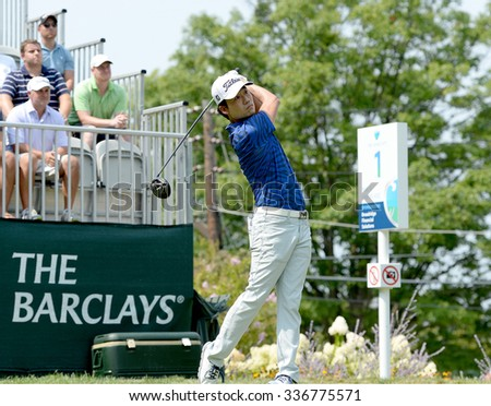 EDISON,NJ-AUGUST 30:Kevin Na watches his shot from the 1st Tee during the final round of the Barclays Tournament held at the Plainfield Country Club in Edison,NJ,August 30,2015.