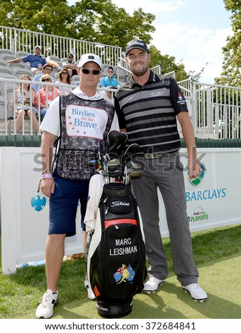 EDISON,NJ-AUGUST 26:Marc Leishman (r) with his Military Caddie during the Barclays Pro-Am held at the Plainfield Country Club in Edison,NJ,August 26,2015.