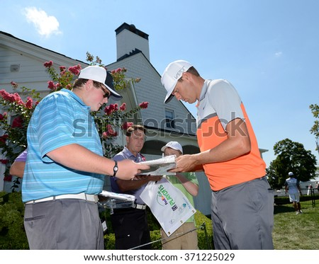 EDISON,NJ-AUGUST 26:Nick Watney stops to give a fan his autograph during the Barclays Pro-Am held at the Plainfield Country Club in Edison,NJ,August 26,2015. - stock photo