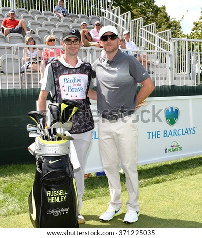Edison,NJ-AUGUST 26:Russell Henley(r) with his Military Caddie during the Barclays Pro-Am held at the Plainfield Country Club in Edison,NJ,August 26,2015. - stock photo