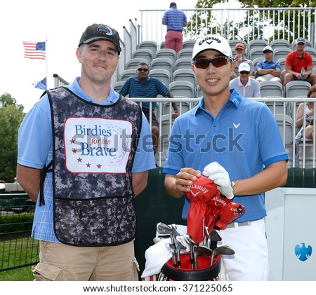 EDISON,NJ-AUGUST 26:Sangmoon Bae (r) with his Military Caddie during the Barclays Pro-Am held at the Plainfield Country Club in Edison,NJ,August 26,2015. - stock photo