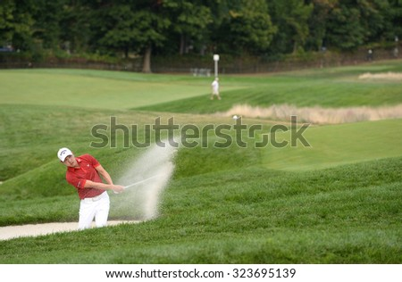 EDISON,NJ-AUGUST 30:Sangmoon Bae takes his shot out of the sand trap at the 18th hole during the final round of the Barclays Tournament held at the Plainfield Country Club in Edison,NJ,August 30,2015.