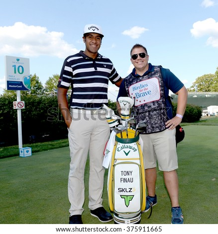 EDISON,NJ-AUGUST 26:Tony Finau (L) with his Military Caddie during the Barclays Pro-Am held at the Plainfield Country Club in Edison,NJ,August 26,2015. - stock photo