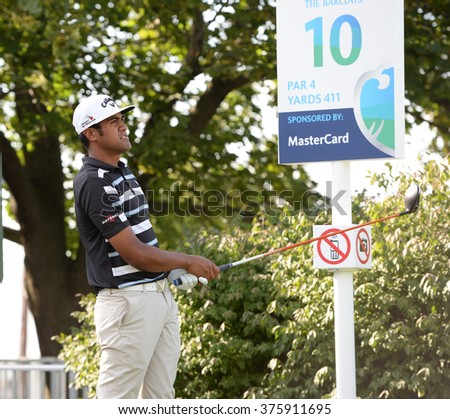 EDISON,NJ-AUGUST 26:Tony Finau watches his shot during the Barclays Pro-Am held at the Plainfield Country Club in Edison,NJ,August 26,2015. - stock photo