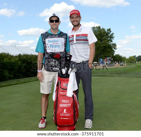 EDISON,NJ-AUGUST 26:Troy Merritt (r) with his Military Caddie during the Barclays Pro-Am held at the Plainfield Country Club in Edison,NJ,August 26,2015. - stock photo