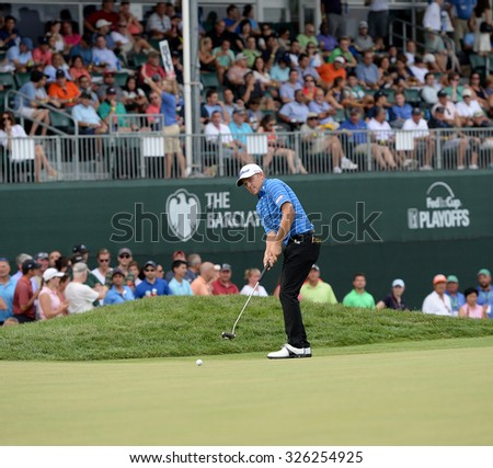 EDISON,NJ-AUGUST 30:Zac Blair watches his putt at the 18th hole during the final round of the Barclays Tournament held at the Plainfield Country Club in Edison,NJ,August 30,2015. - stock photo