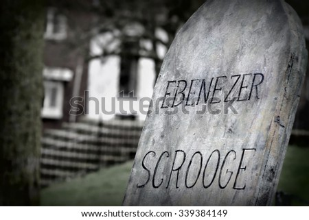 edited version of the ( fictive ) gravestone from Scrooge  . Ebenezer Scrooge is the focal character of Charles Dickens  1843 novella, A Christmas Carol.  - stock photo