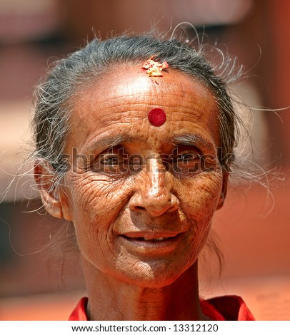 Editorial: An old hindu woman with strong eyes (Nepal) - stock photo