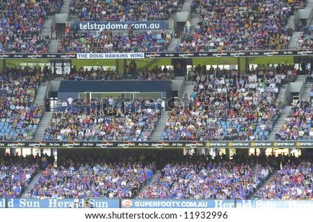 Editorial, crowd at Australian rules football stadium - stock photo