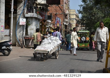 Editorial: Delhi, India: SEPT 10th, 2016: Poor Laborer working hard in Old Delhi Chandni  Chowk Market to earn daily wages