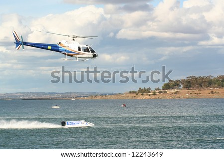 Editorial, news helicopter follows formula 1 boat race at Geelong water front, Corio bay - stock photo