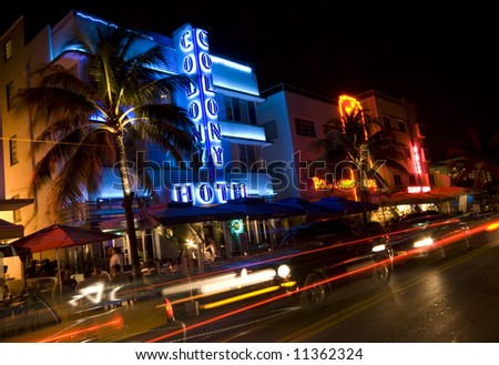 editorial photo of night scene on ocean drive south beach miami florida neon lights art deco architecture hotel and restaurants - stock photo