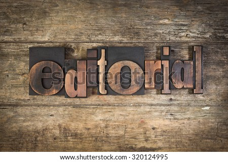 editorial, set with vintage letterpress printing blocks on wooden background - stock photo
