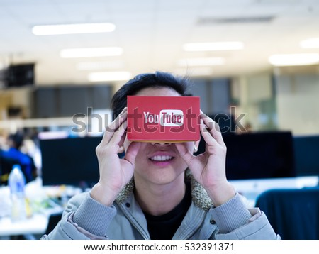 Editorial shot. Bangkok Thailand ,DEC 2016  a man  enjoy youtube video 360 virtual reality experience with google cardboard