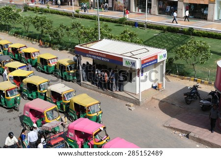 Editorial,06th June 2015:Gurgaon,Delhi,India:Auto or auto rickshaw drivers in queue at Prepaid booths,these booths are equipped with CCTV to capture photos of passengers and drivers for safety purpose - stock photo