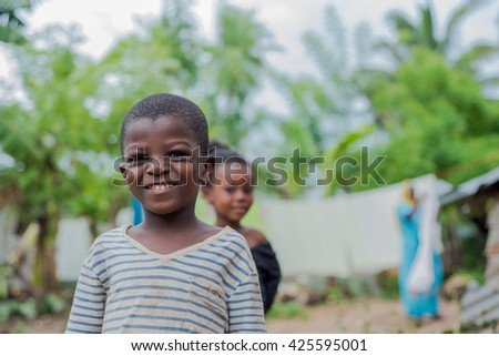 Editorial use. Children in Africa face poor life conditions and health issues. However, they are curious, joyful and eager to play. Zanzibar Island, Tanzania, April 2016