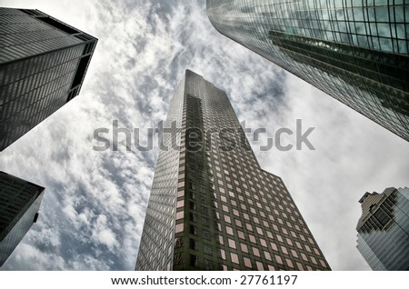 Editorial Use Only: Five Houston Skyscrapers Against Dramatic Sky (Release Information: Editorial Use Only. Use of this image in advertising or for promotional purposes is prohibited.) - stock photo